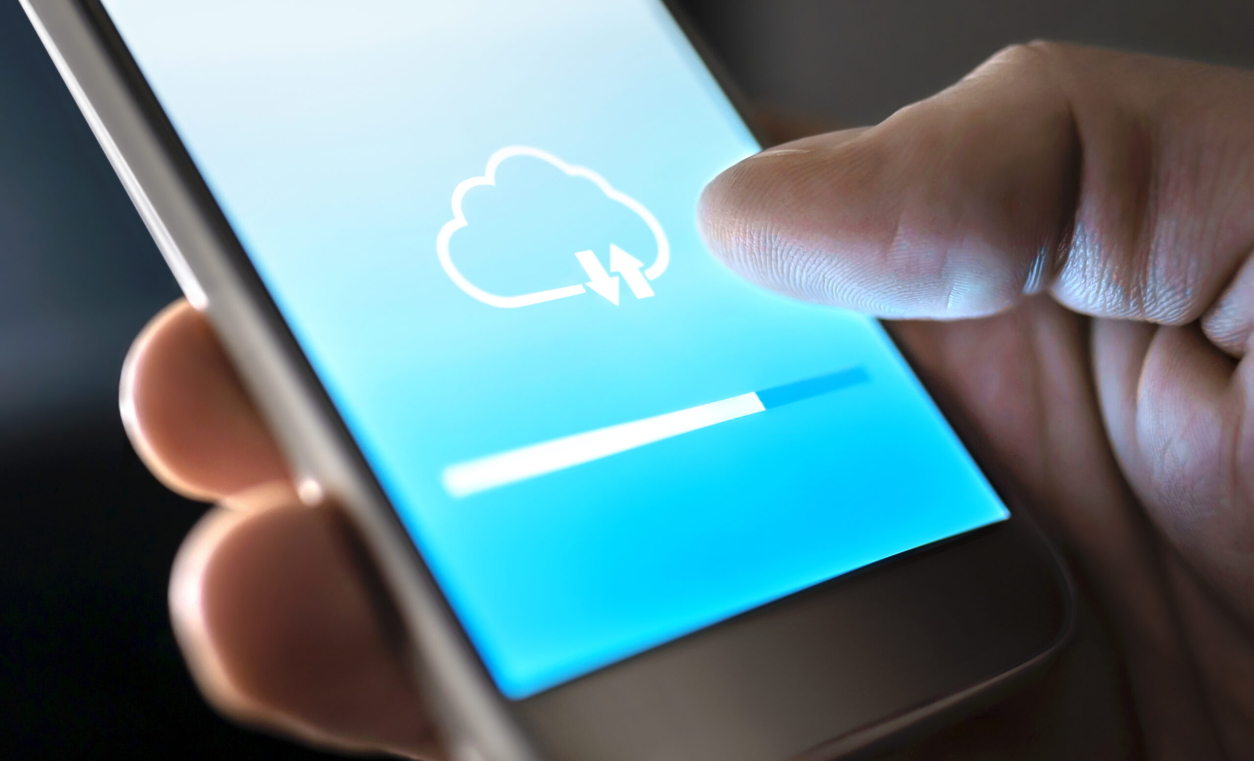 Close Up of Hand Holding Smartphone with Cloud Download Progress Bar on Screen