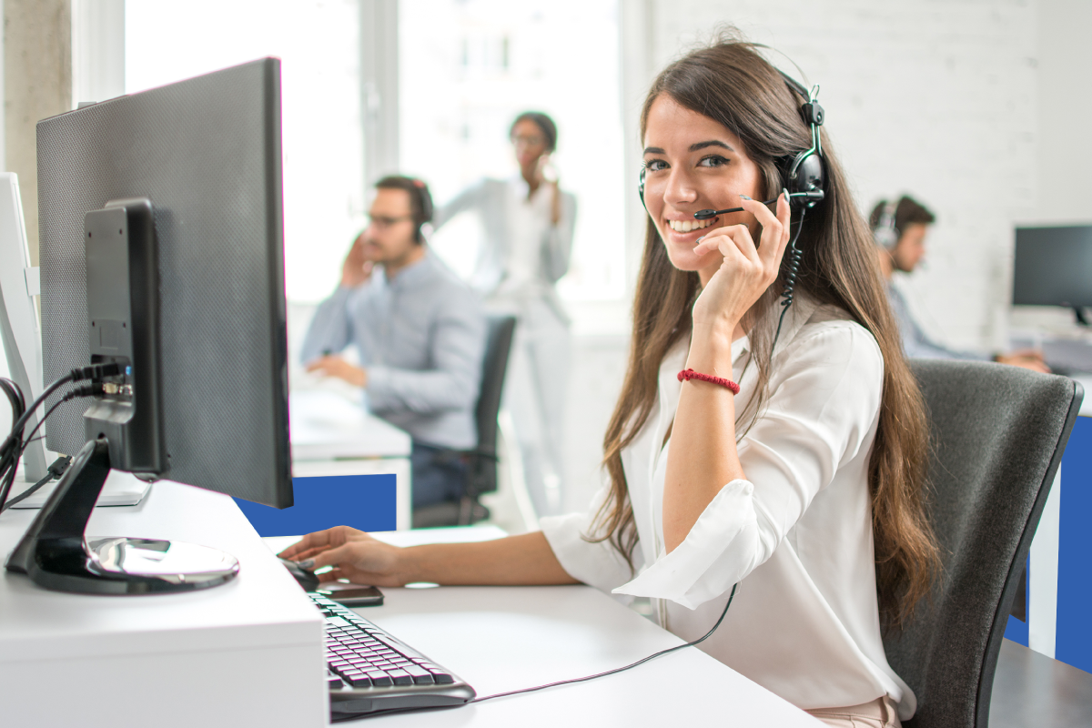 Female IT Technician Wearing Headset, Sitting at Computer
